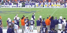 Tuberville was on the sideline once again---Tucker Tuberville (no. 16).